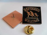 REFUGEES WELCOME ORANGE PIN